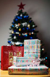 Gifts in front of decorated Christmas Tree Royalty Free Stock Images