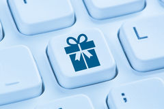 Gifts gift present online shopping ordering internet shop concep. T symbol blue computer keyboard Stock Photography