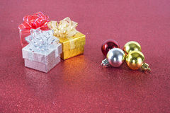 Gifts with glitter background. Christmas gift, glitter background balls Stock Images