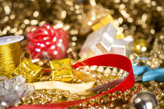 Gifts with glitter background. Gift, golden bow, red bow, glitter Stock Photo