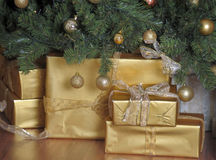 Gifts in gold packaging Royalty Free Stock Image