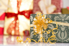 Gifts with golden ribbons Royalty Free Stock Photography