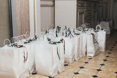 Gifts for the guests in white paper packages Royalty Free Stock Photo
