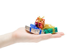 Gifts in a hand Stock Image