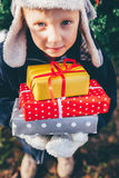 Gifts in the hands of boys Stock Photos