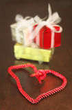 Gifts and heart shaped braid Stock Images