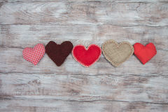 Gifts, hearts, bows and ornaments on wooden table. Valentines Day Royalty Free Stock Photo
