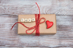 Gifts, hearts, bows and ornaments on wooden table. Valentines Day Stock Photos