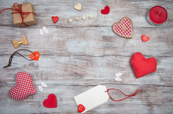 Gifts, hearts, bows and ornaments on wooden table. Valentines Day Stock Image