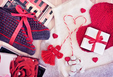 Gifts for the holiday. Knitwear and candy. Royalty Free Stock Photos