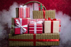 Gifts for Holidays, Christmas, anniversary on a beautiful red ba Stock Photos