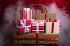 Gifts for Holidays, Christmas, anniversary on a beautiful red ba Royalty Free Stock Photo