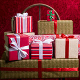 Gifts for Holidays, Christmas, anniversary on beautiful red back Stock Photo
