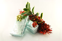 Gifts and Holly Stock Photography