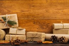 Gifts from Kraft paper beautifully decorated for Christmas, are on the table. Gifts from Kraft paper beautifully decorated for Christmas, are on table stock photo