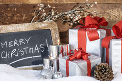 Gifts with lighted candles Royalty Free Stock Photography