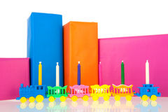 Gifts in many colors with train and candles Stock Image