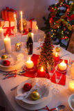 Gifts near a Christmas tree in the candlelight Stock Image