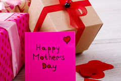 Gifts near Mother`s Day card. Royalty Free Stock Image