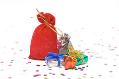 Gifts near santas sack. And confetti on white background Royalty Free Stock Photos