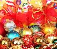 Gifts and Ornaments. Colorful Chrismas tree ornaments focus on the foreground, blurred background Stock Photos