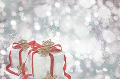 Gifts over Glow glitter background. Elegant abstract background with bokeh Stock Photography