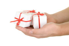 Gifts in palms. On  white background Royalty Free Stock Photography