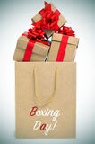 Gifts and paper bag with the text boxing day, vignetted Stock Photo