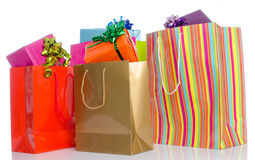 Gifts in paper shopping bags stock image