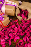 Gifts and  petals Royalty Free Stock Image