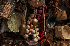 Gifts from Puglia. Gadgets and souvenirs from the city of Bari. Cowbell, handmade wicker baskets, garlic and chilli and other typical gifts of Puglia, southern royalty free stock images