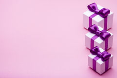 Gifts with purple ribbons Royalty Free Stock Photo