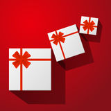 Gifts with red bow with ribbons Royalty Free Stock Images