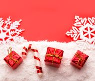 Gifts on red. Red gift boxes with white snow shot royalty free stock image