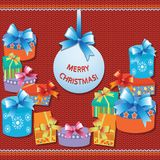 Gifts on a red knitted background. MERRY CHRISTMAS! Bright gift background. Design of banners, posters, greeting cards, invitation. S Royalty Free Stock Photo