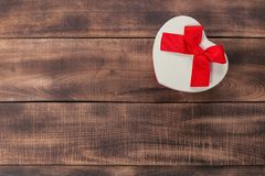 Gifts with red ribbon on the wooden table royalty free stock photo
