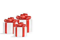 Gifts with red ribbons isolated on white. Christmas gift, red bow isolated Royalty Free Stock Images