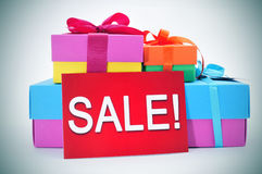Gifts and a red signboard with the word sale Royalty Free Stock Image
