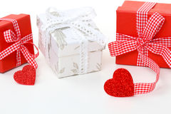 Gifts in red and white with heart Stock Photography