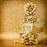 Gifts ribbon bow on golden background Vintage style Stock Photography