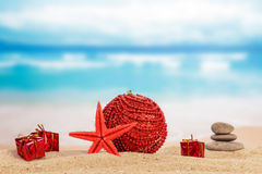 Gifts on sand Stock Photography