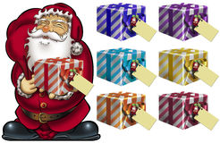 Gifts from Santa. Santa holding colorful gift packages with blank greeting cards Stock Photo