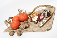 Gifts from santa claus. Decoration with tangerines, nuts and a sach Royalty Free Stock Photos