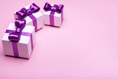 Gifts with satin bows Stock Photography