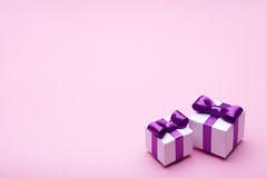 Gifts with satin bows on pink Stock Photos