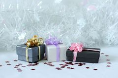 Gifts with shiny bows on a Christmas party decor Royalty Free Stock Photo