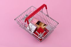 Gifts in shopping cart Stock Image