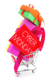 Gifts in a shopping cart and signboard with the text cyber monda Stock Photo