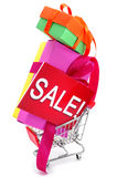 Gifts and a signboard with the word sale in a shopping cart Royalty Free Stock Image