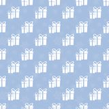 Gifts silhouette on a blue background. Seamless vector pattern. Element of design Stock Image